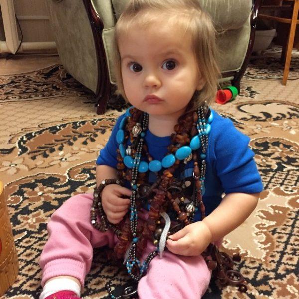 Nika wearing necklaces